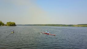 Kayakers Training On Canoe. Active children training in kayak on the river stock footage
