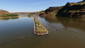 Kayakers Travel Along the Palouse River from the Snake at Lyons Ferry. Kayaks and paddlers make thier way upstream into the Palouse stock footage