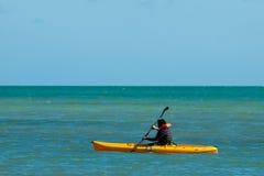 Kayaking. Man in yellow kayak at Key West, Florida Royalty Free Stock Photography