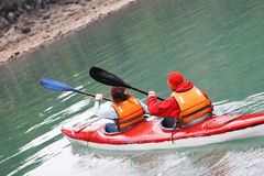 Kayaking. A man and woman head off on a kayaking trip - health and fitness Royalty Free Stock Image