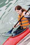 Kayaking. Portrait of a woman kayaking - health and fitness Stock Photos