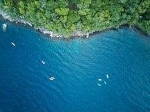 Kayaking adventure above view. Group of kayak in blue water royalty free stock photos