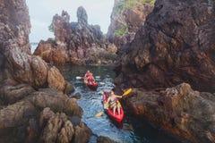 Kayaking, adventure travel, group of people on kayaks. Canoe between cliffs stock photo