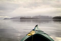 Kayaking in the Alaskan Wilderness. Paddling through and around the wild and wonderful islands of southeast Alaskan wilderness Stock Photo