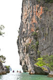 Kayaking along cliffs in Andaman sea Royalty Free Stock Image