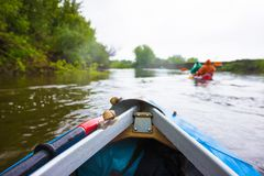 Kayaking on beautiful nature at summer sunny day. Sport people having fun stock image