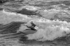Kayaking Brennan's Wave. Missoula, Montana - 1 July 2014 - Man kayaking Brennan's Wave on the Clark Fork River royalty free stock images