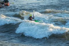 Kayaking on Brennan's Wave. Missoula, Montana: 01 July 2014 - Man kayaking Brennan's Wave on the Clark Fork River royalty free stock photos