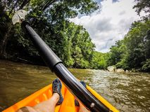 Kayaking on broad river in the mountains Royalty Free Stock Image