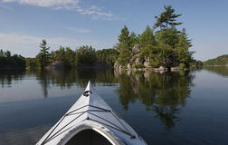 Kayaking on a Calm Lake Royalty Free Stock Photos