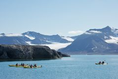 Kayaking on the Calm Water near New London in Svalbard Royalty Free Stock Photo
