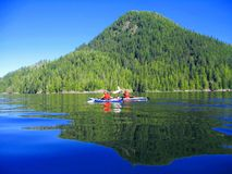 Kayaking in Calm Waters at McKay Island, Clayoquot Sound north of Tofino, British Columbia royalty free stock photography
