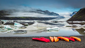 Kayaking on a cold lake near a glacier, Iceland Stock Photo
