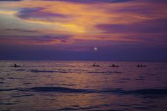 Kayaking in the dawn, sunset over Pacific Ocean Stock Images