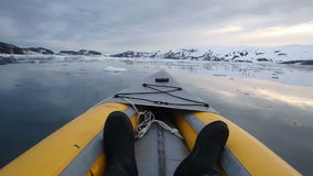 Kayaking Deception Bay, Antarctica at sunset stock video