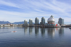Kayaking the Eastside of False Creek. A lone kayaker paddles across Vancouvers False Creek Royalty Free Stock Image