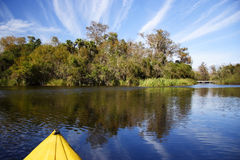Kayaking the Everglades. A kayak cruises the Turner River in the Florida Everglades, Big Cypress National Preserve Royalty Free Stock Photography