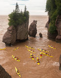 Kayaking the flowerpots. A group of people kayaking the muddy waters of the Bay of Fundy between the flower pot rocks at Hopewell Rocks in New Brunswick, Canada royalty free stock photo