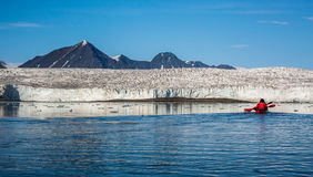 Kayaking in front of a glacier. Svalbard Royalty Free Stock Image