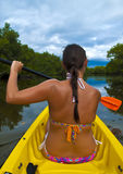 Kayaking Girl. Brunette girl kayaking through lover's key kayak trail royalty free stock image