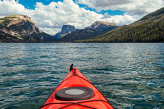 Green River Lakes, Wyoming. A kayak on Lower Green River Lake is pointed toward Square Top mountain in the distance. The Lakes are part of the incredibly scenic Royalty Free Stock Image