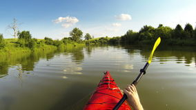 Kayaking on the lake stock video footage