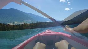 Kayaking on the lake. Front view of the mountains while kayaking on the lake stock footage