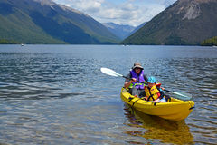 Kayaking on Lake Rotoiti, Nlson Lakes, New Zealand royalty free stock photos