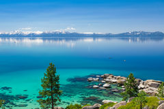 Kayaking Lake Tahoe. There are two kayaks photographed in sunny day from east shore of Lake Tahoe royalty free stock photography