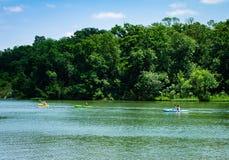 Kayaking on the lake. Three people kayaking on a lake Stock Photos