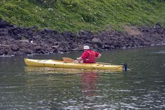 Kayaking Man. Man Kayaking on a river Royalty Free Stock Photography