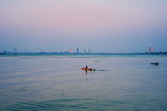 Kayaking in the middle of a quiet calm water. A Kayak in the middle of a quiet calm water Royalty Free Stock Images