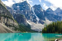 Moraine Lake, kayaking on turquoise Moraine Lake with Rocky Mountains, Canada stock photo
