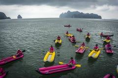 Kayaking near limestone cliffs of Andaman Sea. Thailand Stock Images