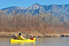 Kayaking near the mountains Stock Photo