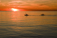Kayaking no por do sol Foto de Stock