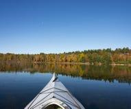 Kayaking on a Northern Lake in Autumn Royalty Free Stock Image