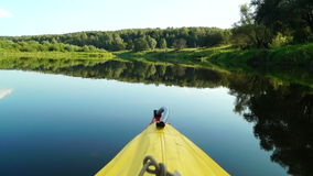 Kayaking on picturesque river. Evening trip in kayak along the picturesque river stock video footage