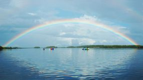 Kayaking in Polar Karelia with rainbow Royalty Free Stock Image
