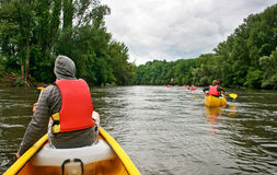 Kayaking on river Dordogne in France. Young people kayaking on river Dordogne in Southern France stock photos
