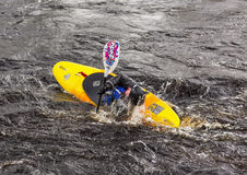 Kayaking on the river Findhorn. Royalty Free Stock Image