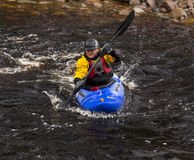 Kayaking on the river Findhorn. Royalty Free Stock Photo