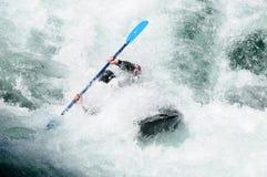 Kayaking in rough water Royalty Free Stock Photo
