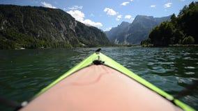 Kayaking on the scenic Alpine Lake Almsee Austria. Lake Alm, Salzkammergut in the Almtal Valley. Summer Scenery stock video