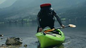 Kayaking on the scenic mountain lake.