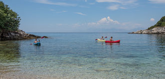 Kayaking in the sea. 3 People kayaking in the sea royalty free stock images