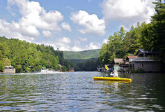 Kayaking and Skiing on Lake stock photography