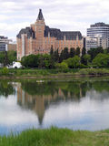 Kayaking on the South Saskatchewan River. Kayaker in reflection of the Delta Bessborough Hotel on the South Saskatchewan River, Saskatoon, Saskatchewan Royalty Free Stock Image