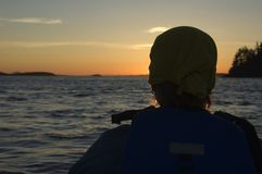 Kayaking in the sundown. Kayaking into the sundown on the pacific ocean. After a long day of kayaking and searching for orcas and humpbacks we had this amazing Royalty Free Stock Photo