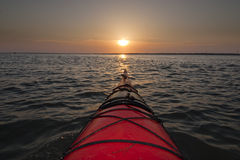 Kayaking into sunrise Royalty Free Stock Photography